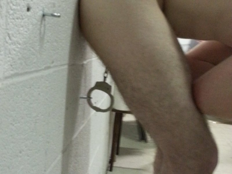 Balls Cuffed to Wall