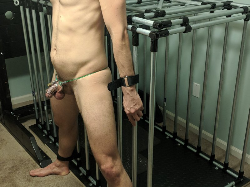 Chastity sub Bound to Cage